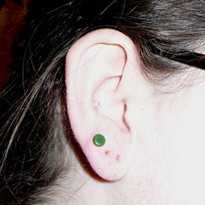 "1""  SF green glass eyelets (pair) -- Photo # 54240"